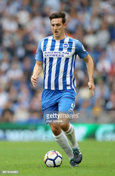 Lewis Dunk of Brighton Hove Albion runs with the ball during the Premier League match between Brighton and Hove Albion and Everton at Amex Stadium on...