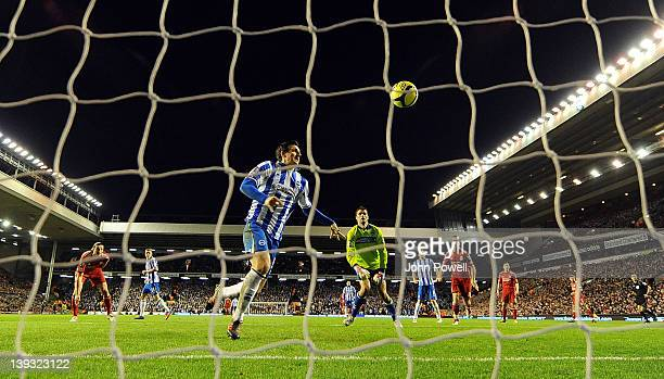 Lewis Dunk of Brighton Hove Albion scores an own goal during the FA Cup Fifth round match between Liverpool and Brighton and Hove Albion at Anfield...