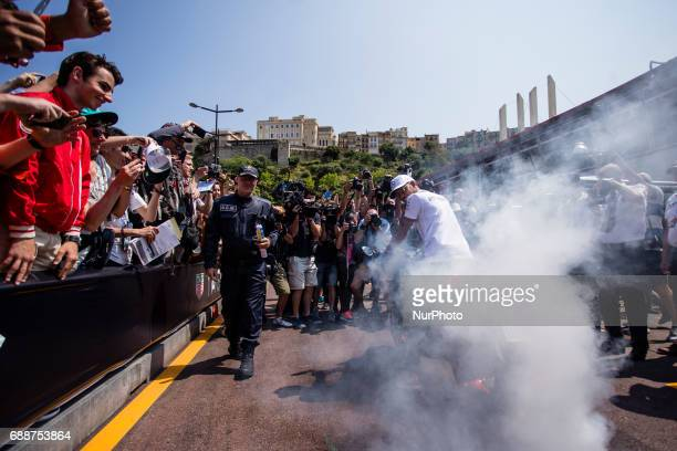 Lewis from Great Britain of Mercedes W08 Hybrid EQ Power team Mercedes GP with his motorbike saluding to the fans during the Monaco Grand Prix of the...