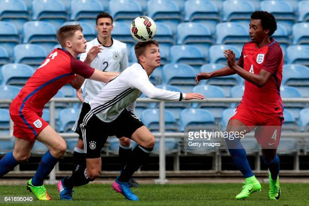 Lewis Gibson and Tashan Oakley Boothe of England U17 challenge JannFiete Arp of Germany U17 during the U17 Algarve Cup Tournament Match between...