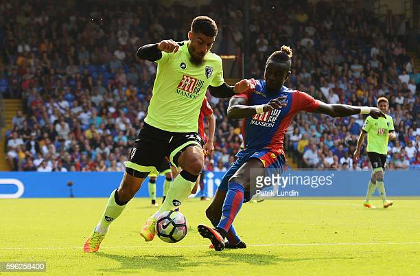 Lewis Grabban of AFC Bournemouth takes on Pape Souare of Crystal Palace during the Premier League match between Crystal Palace and AFC Bournemouth at...