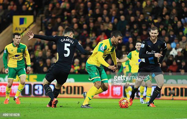 Lewis Grabban of Norwich City beats Gabriel Paulista of Arsenal as he scores their first and equalising goal during the Barclays Premier League match...