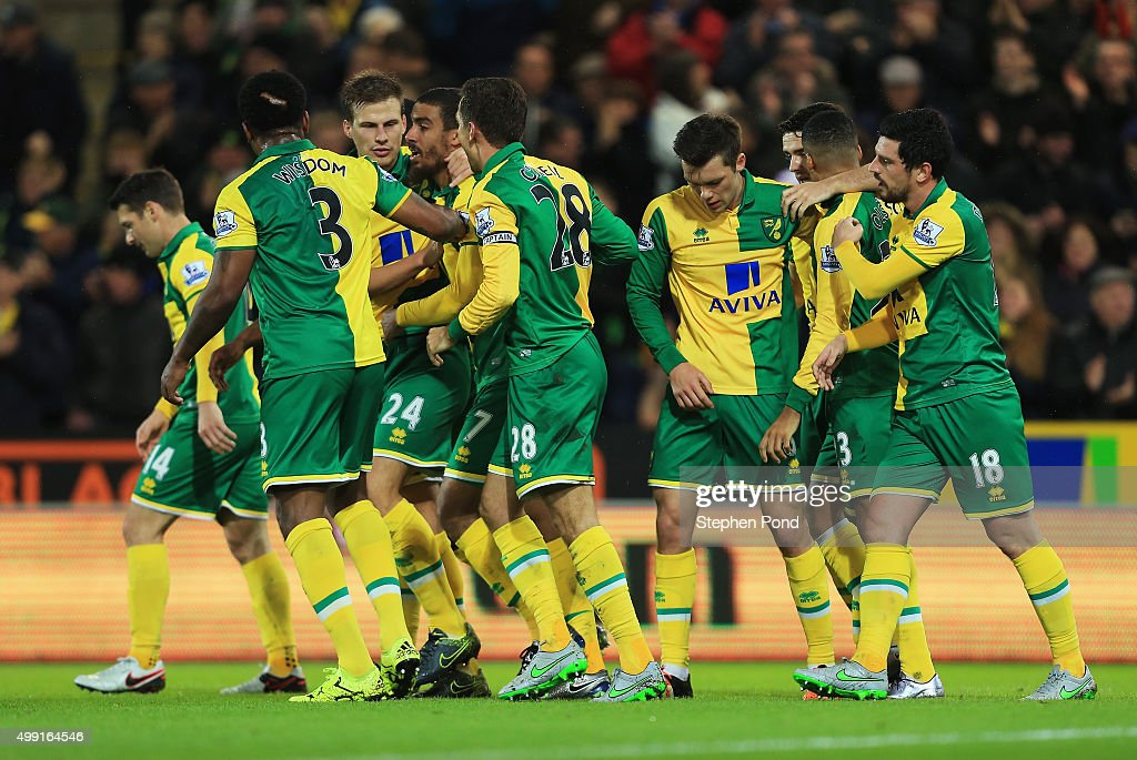 Lewis Grabban of Norwich City (7) celebrates team mates as he scores their first and equalising goal during the Barclays Premier League match between Norwich City and Arsenal at Carrow Road on November 29, 2015 in Norwich, England.