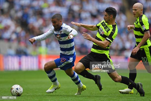 Lewis Grabban of Reading attempts to get away from Christopher Schindler of Huddersfield Town during the Sky Bet Championship play off final between...
