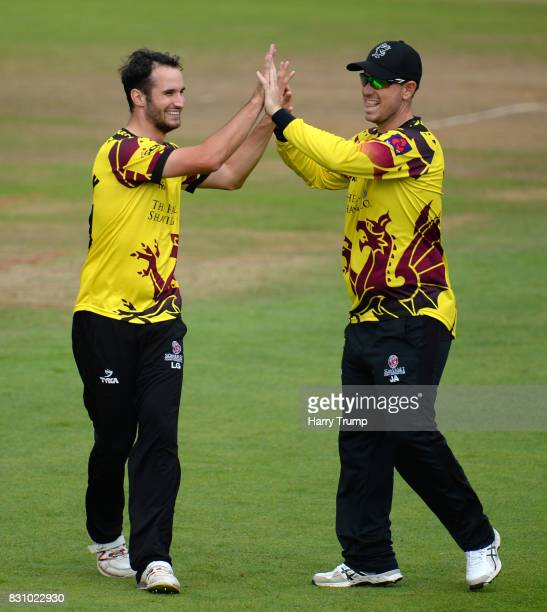 Lewis Gregory and Jim Allenby of Somerset celebrates the wicket of Colin Ingram of Glamorgan during the NatWest T20 Blast match between Somerset and...