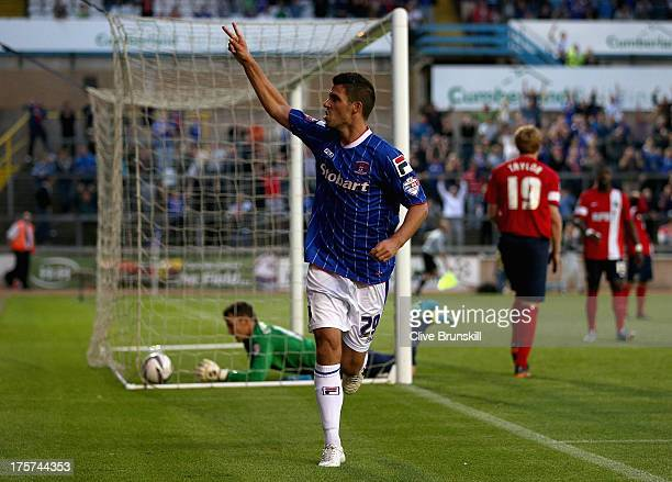 Lewis Guy of Carlisle United celebrates after scoring the equaliser and his teams second goal during the Capital One Cup first round match between...