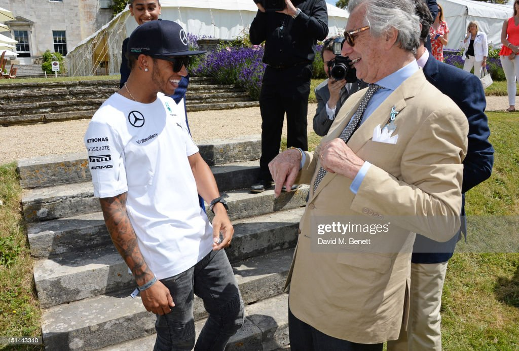 Lewis Hamilton (L) and Arnaud Bamberger attend the Cartier Style & Luxury Lunch at the Goodwood Festival of Speed on June 29, 2014 in Chichester, England.