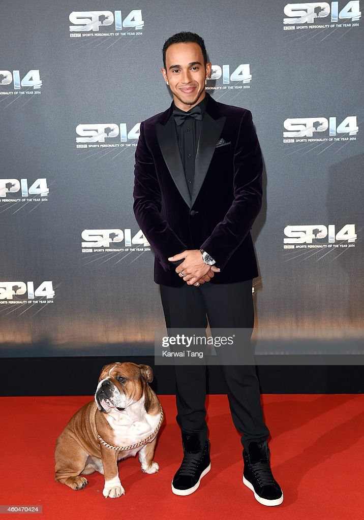 Lewis Hamilton and his dog Roscoe attend the BBC Sports Personality of the Year awards at The Hydro on December 14 2014 in Glasgow Scotland