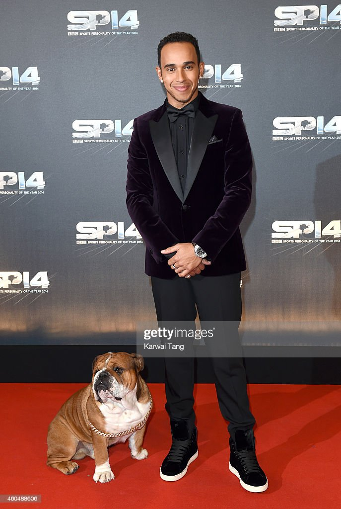 Lewis Hamilton and his dog Roscoe attends the BBC Sports Personality of the Year awards at The Hydro on December 14, 2014 in Glasgow, Scotland.