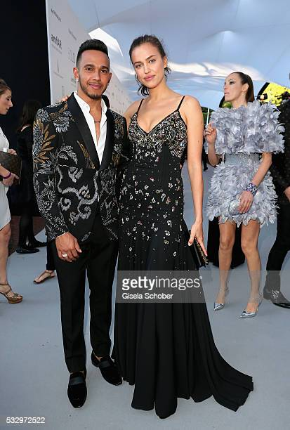 Lewis Hamilton and Irina Shayk attend the amfAR's 23rd Cinema Against AIDS Gala at Hotel du CapEdenRoc on May 19 2016 in Cap d'Antibes France
