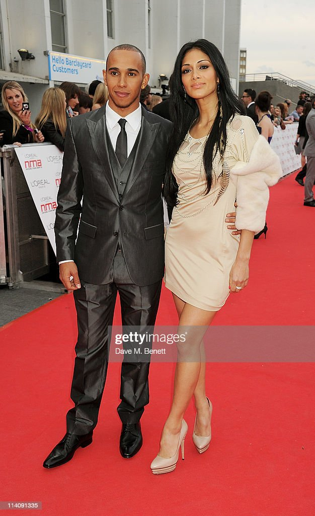 Lewis Hamilton and Nicole Scherzinger arrive at the 2011 National Movie Awards held at Wembley Arena on May 11 2011 in London England
