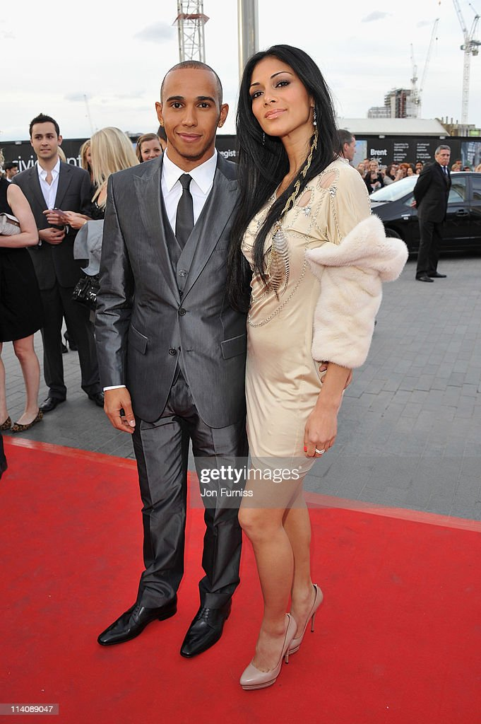 Lewis Hamilton and Nicole Scherzinger arrive for the L'Oreal National Movie Awards 2011 at Wembley Arena on May 11 2011 in London England