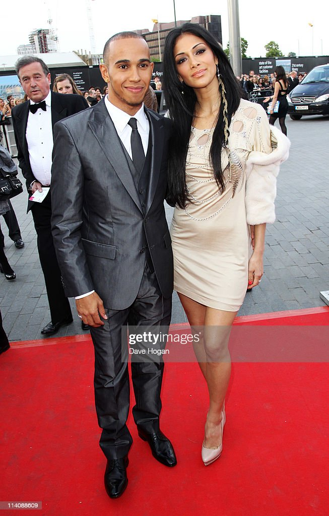Lewis Hamilton and Nicole Scherzinger attend the National Movie Awards 2011 at Wembley arena on May 11 2011 in London England