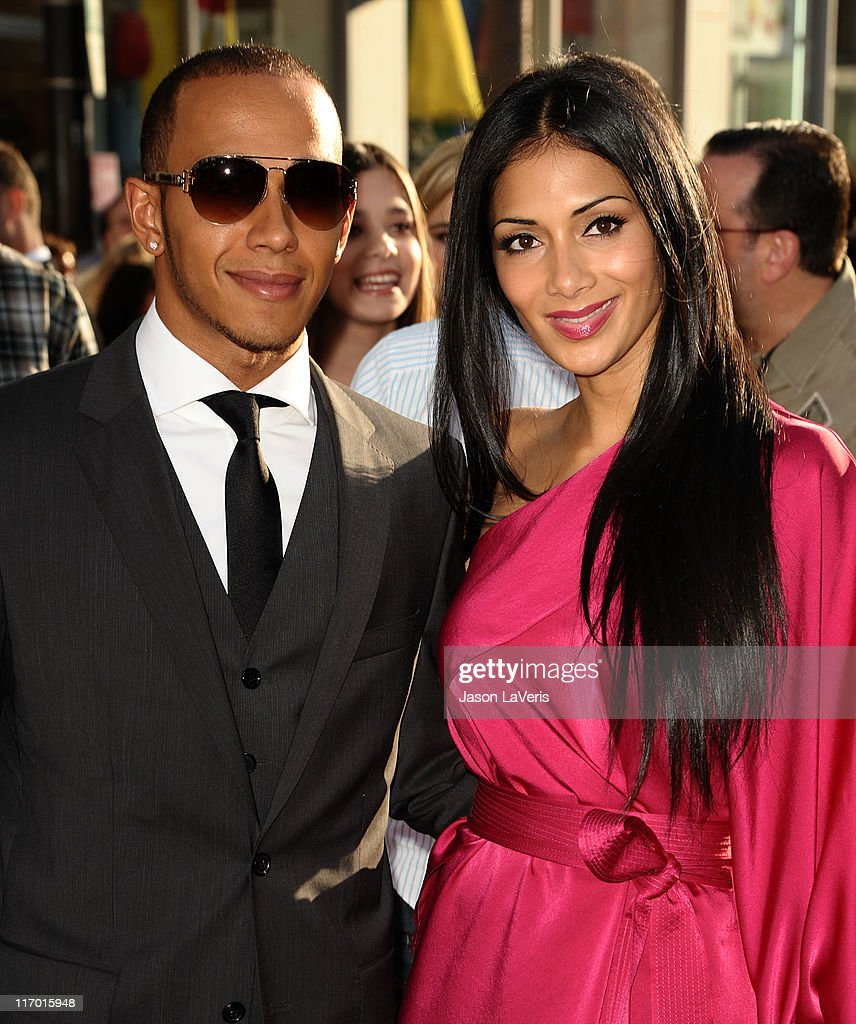 <a gi-track='captionPersonalityLinkClicked' href=/galleries/search?phrase=Lewis+Hamilton+-+Racecar+Driver&family=editorial&specificpeople=586983 ng-click='$event.stopPropagation()'>Lewis Hamilton</a> and <a gi-track='captionPersonalityLinkClicked' href=/galleries/search?phrase=Nicole+Scherzinger&family=editorial&specificpeople=678971 ng-click='$event.stopPropagation()'>Nicole Scherzinger</a> attend the premiere of Disney/Pixar's 'Cars 2' at the El Capitan Theatre on June 18, 2011 in Hollywood, California.