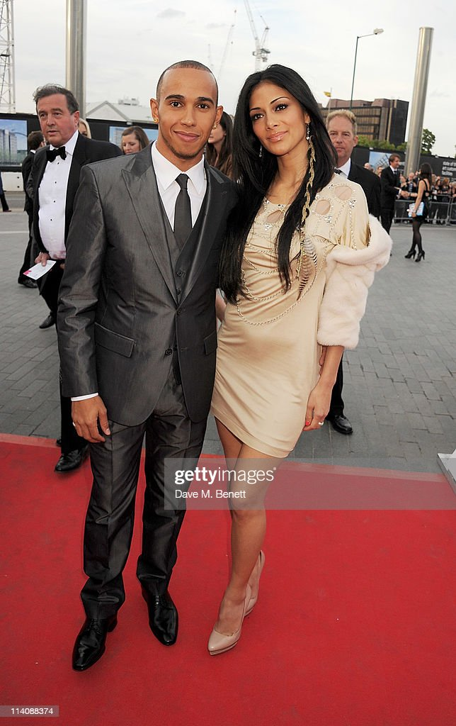 Lewis Hamilton and singer Nicole Scherzinger arrive at the 2011 National Movie Awards held at Wembley Arena on May 11 2011 in London England