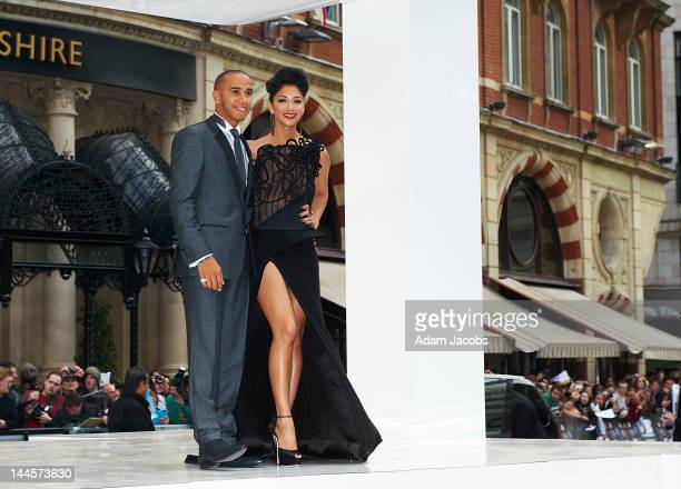 Lewis Hamilton and Singer Nicole Scherzinger attends the premiere for Men In Black 3 at Odeon Leicester Square on May 16 2012 in London England