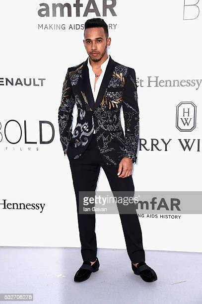 Lewis Hamilton arrives at amfAR's 23rd Cinema Against AIDS Gala at Hotel du CapEdenRoc on May 19 2016 in Cap d'Antibes France