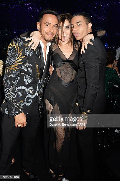 Lewis Hamilton Carine Roitfeld and Olivier Rousteing attend amfAR's 23rd Cinema Against AIDS Gala at Hotel du CapEdenRoc on May 19 2016 in Cap...