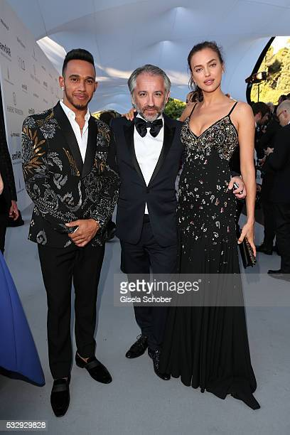 Lewis Hamilton Cyril Chapuy and Irina Shayk attend the amfAR's 23rd Cinema Against AIDS Gala at Hotel du CapEdenRoc on May 19 2016 in Cap d'Antibes...