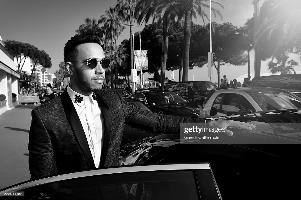 Lewis Hamilton departs the Martinez Hotel during the 69th annual Cannes Film Festival on May 17 2016 in Cannes France