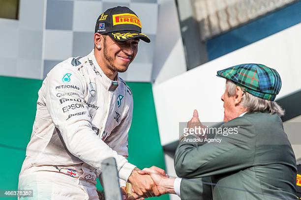 Lewis Hamilton from the Mercedes AMG Petronas F1 Team is congratulated by Jackie Stewart during the Rolex Australian Formula 1 Grand Prix race Albert...
