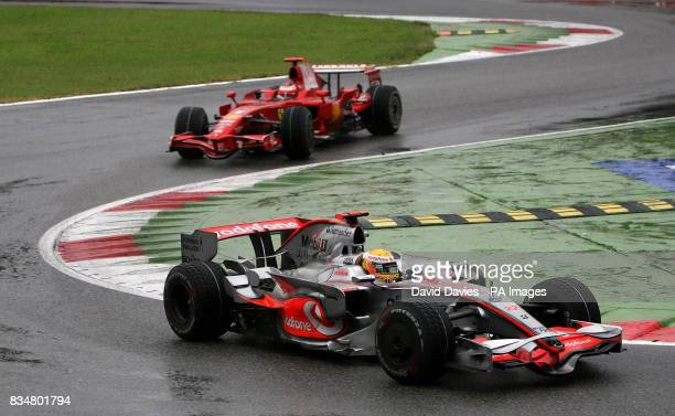 Lewis Hamilton leads Kimi Raikkonen through the first chicane after the pair started the race well down the field during the Italian Grand Prix at...