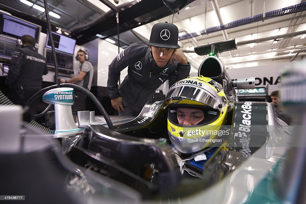 <a gi-track='captionPersonalityLinkClicked' href=/galleries/search?phrase=Lewis+Hamilton+-+Racecar+Driver&family=editorial&specificpeople=586983 ng-click='$event.stopPropagation()'>Lewis Hamilton</a> looks on as <a gi-track='captionPersonalityLinkClicked' href=/galleries/search?phrase=Nico+Rosberg&family=editorial&specificpeople=800808 ng-click='$event.stopPropagation()'>Nico Rosberg</a> of Germany and Mercedes GP prepares to drive during Formula One Winter Testing at the Circuito de Jerez on January 29, 2014 in Jerez de la Frontera, Spain.