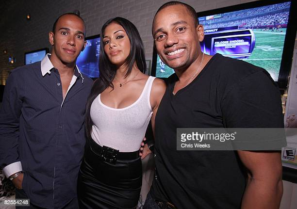 Lewis Hamilton music recording artist Nicole Scherzinger of the Pussycat Dolls and Hill Harper attend the 20th Anniversary of the Madden NFL...
