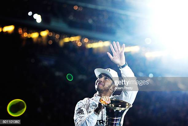 Lewis Hamilton of Great Britain and 2015 F1 World Champion waves to the crowd before the first round of races in the MecedesAMG A 45 of the Stars and...