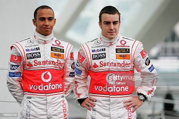 Lewis Hamilton of Great Britain and Fernando Alonso of Spain pose for the media during the launch of the Vodafone McLaren Mercedes 2007 MP422 F1...