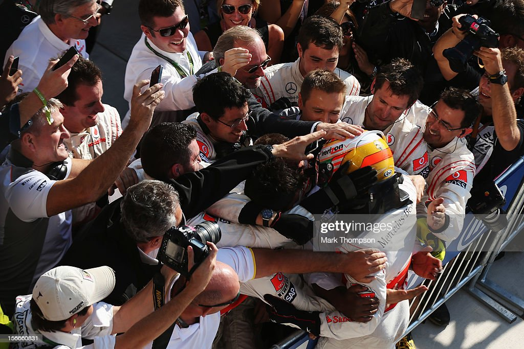 <a gi-track='captionPersonalityLinkClicked' href=/galleries/search?phrase=Lewis+Hamilton&family=editorial&specificpeople=586983 ng-click='$event.stopPropagation()'>Lewis Hamilton</a> of Great Britain and McLaren celebrates in parc ferme after winning the United States Formula One Grand Prix at the Circuit of the Americas on November 18, 2012 in Austin, Texas.