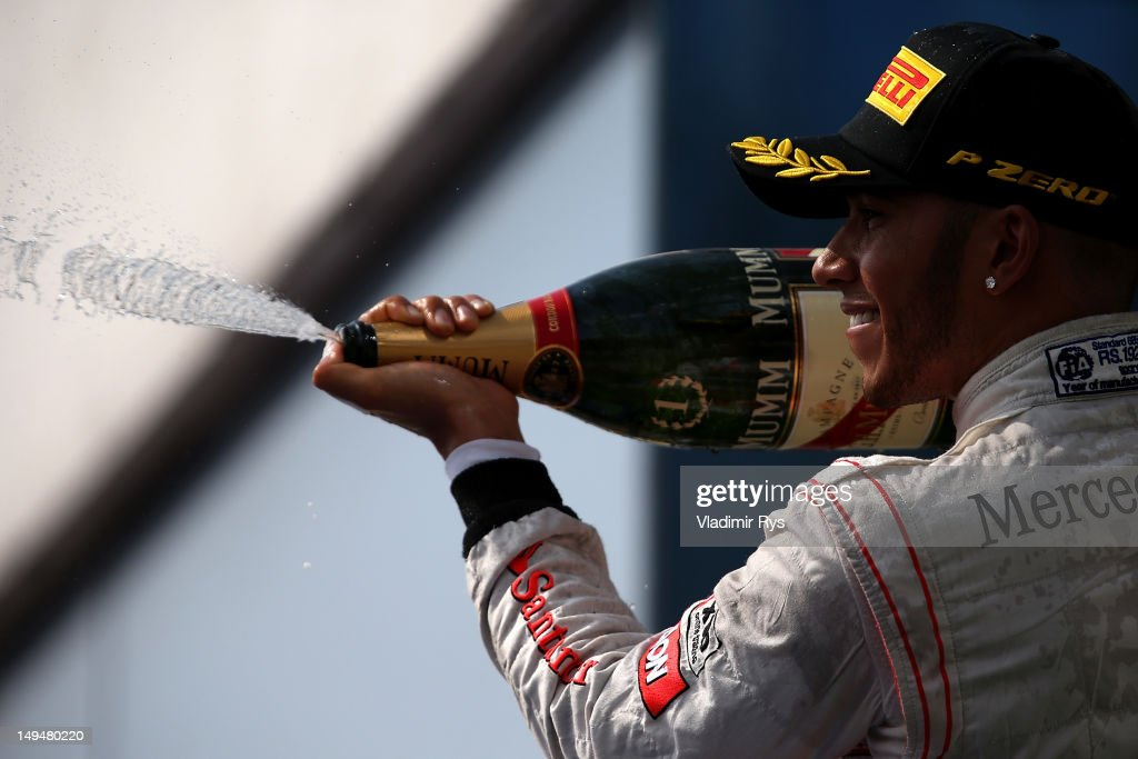 Lewis Hamilton of Great Britain and McLaren celebrates on the podium after winning the Hungarian Formula One Grand Prix at the Hungaroring on July 29, 2012 in Budapest, Hungary.