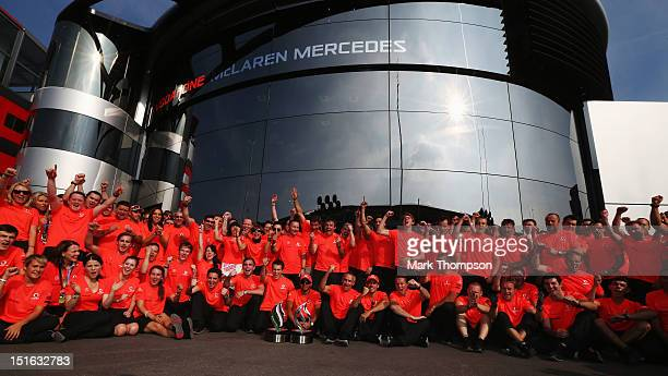 Lewis Hamilton of Great Britain and McLaren celebrates with team mates in the paddock after winning the Italian Formula One Grand Prix at the...