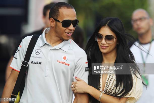 Lewis Hamilton of Great Britain and McLaren Mercedes and his girlfriend Nicole Scherzinger of the Pussycat Dolls walk in the paddock following...