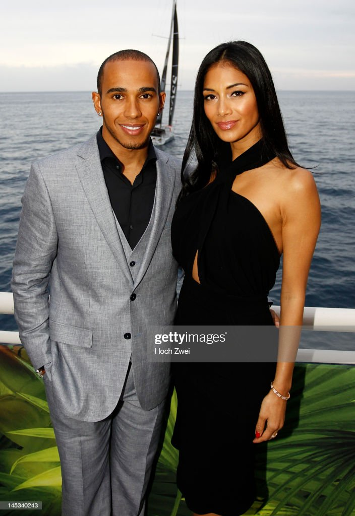 <a gi-track='captionPersonalityLinkClicked' href=/galleries/search?phrase=Lewis+Hamilton&family=editorial&specificpeople=586983 ng-click='$event.stopPropagation()'>Lewis Hamilton</a> of Great Britain and McLaren Mercedes and his girlfriend <a gi-track='captionPersonalityLinkClicked' href=/galleries/search?phrase=Nicole+Scherzinger&family=editorial&specificpeople=678971 ng-click='$event.stopPropagation()'>Nicole Scherzinger</a> of the Pussycat Dolls are seen at an event following qualifying for the Monaco Formula One Grand Prix at the Circuit de Monaco on May 26, 2012 in Monte Carlo, Monaco.