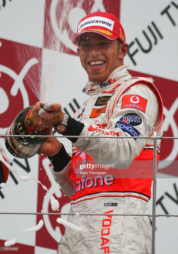 Lewis Hamilton of Great Britain and McLaren Mercedes celebrates on the podium after winning the Japanese Formula One Grand Prix at the Fuji Speedway on September 30, 2007 in Shizuoka, Japan.