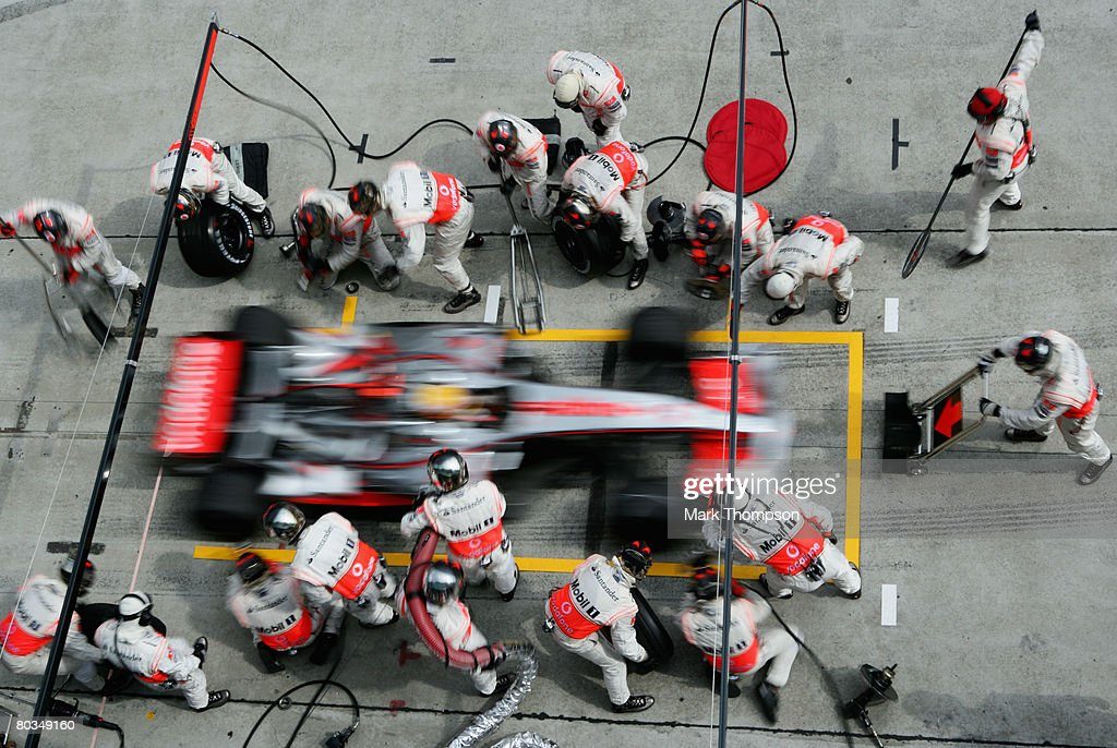 Lewis Hamilton of Great Britain and McLaren Mercedes comes in for a pitstop during the Malaysian Formula One Grand Prix at the Sepang Circuit on March 23, 2008 in Kuala Lumpur, Malaysia.