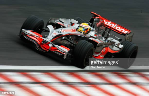 Lewis Hamilton of Great Britain and McLaren Mercedes drives on his way to winning the Formula One World Championship during the Brazilian Formula One...
