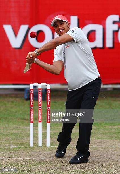 Lewis Hamilton of Great Britain and McLaren Mercedes faces a delivery from Australian cricket legend Shane Warne in a 'backyard' cricket match in...