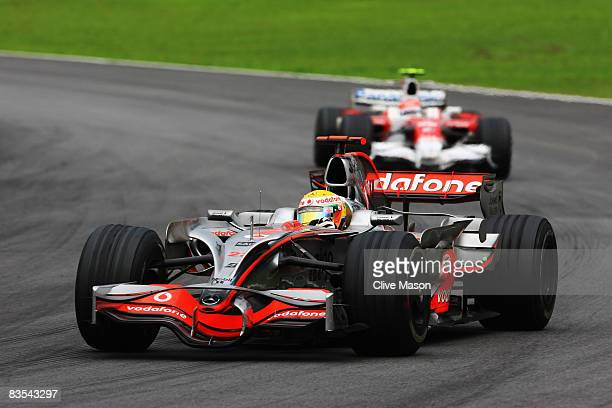 Lewis Hamilton of Great Britain and McLaren Mercedes leads from Timo Glock of Germany and Toyota on his way to winning the Formula One World...
