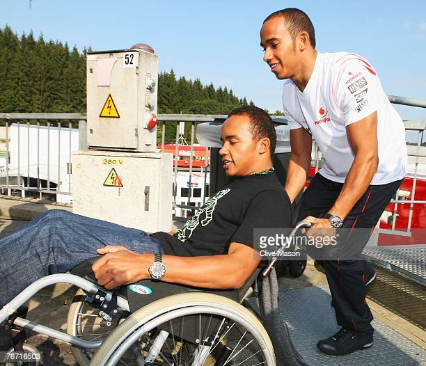 SPA FRANCORCHAMPS BELGIUM SEPTEMBER 13 Lewis Hamilton of Great Britain and McLaren Mercedes pushes his halfbrother Nick's wheelchair during previews...