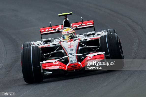 Lewis Hamilton of Great Britain and McLaren Mercedes races during the F1 Grand Prix of USA at the Indianapolis Motor Speedway on June 17 2007 in...