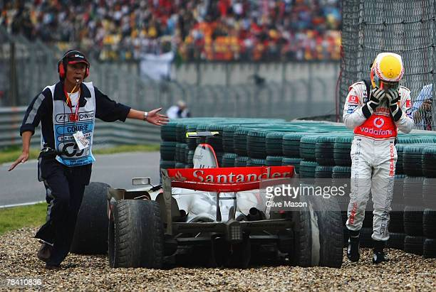 Lewis Hamilton of Great Britain and McLaren Mercedes retires early from the Chinese Formula One Grand Prix at the Shanghai International Circuit on...