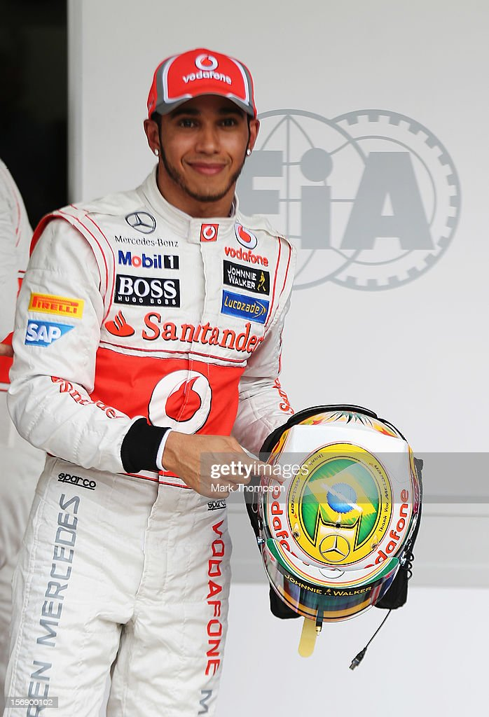 Lewis Hamilton of Great Britain and McLaren shows his specially designed helmet giving thanks to his team as he finishes first during qualifying for the Brazilian Formula One Grand Prix at the Autodromo Jose Carlos Pace on November 24, 2012 in Sao Paulo, Brazil.