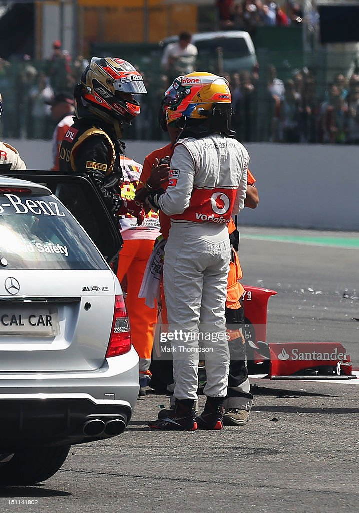 <a gi-track='captionPersonalityLinkClicked' href=/galleries/search?phrase=Lewis+Hamilton&family=editorial&specificpeople=586983 ng-click='$event.stopPropagation()'>Lewis Hamilton</a> (R) of Great Britain and McLaren talks with <a gi-track='captionPersonalityLinkClicked' href=/galleries/search?phrase=Romain+Grosjean&family=editorial&specificpeople=4858519 ng-click='$event.stopPropagation()'>Romain Grosjean</a> (L) of France and Lotus after they crash out at the first corner at the start of the Belgian Grand Prix at the Circuit of Spa Francorchamps on September 2, 2012 in Spa Francorchamps, Belgium.