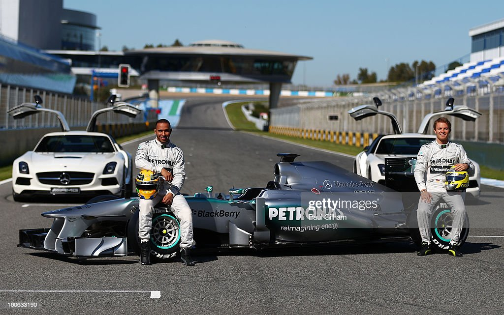 <a gi-track='captionPersonalityLinkClicked' href=/galleries/search?phrase=Lewis+Hamilton&family=editorial&specificpeople=586983 ng-click='$event.stopPropagation()'>Lewis Hamilton</a> of Great Britain and Mercedes and <a gi-track='captionPersonalityLinkClicked' href=/galleries/search?phrase=Nico+Rosberg&family=editorial&specificpeople=800808 ng-click='$event.stopPropagation()'>Nico Rosberg</a> of Germany and Mercedes pose during the Mercedes GP F1 W04 Launch at Circuito de Jerez on February 4, 2013 in Jerez de la Frontera, Spain.