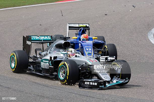 Lewis Hamilton of Great Britain and Mercedes damages his front wing during the Formula One Grand Prix of China at Shanghai International Circuit on...