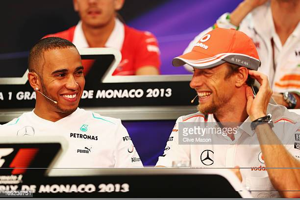 Lewis Hamilton of Great Britain and Mercedes GP and Jenson Button of Great Britain and McLaren attend the drivers press conference during previews to...