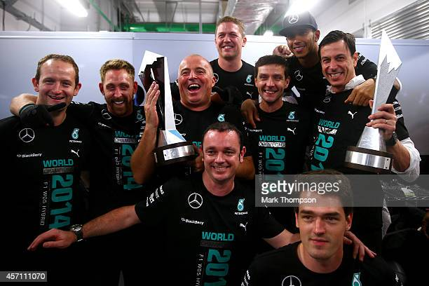 Lewis Hamilton of Great Britain and Mercedes GP and Mercedes GP Executive Director Toto Wolff celebrate with the team after becoming the 2014 World...