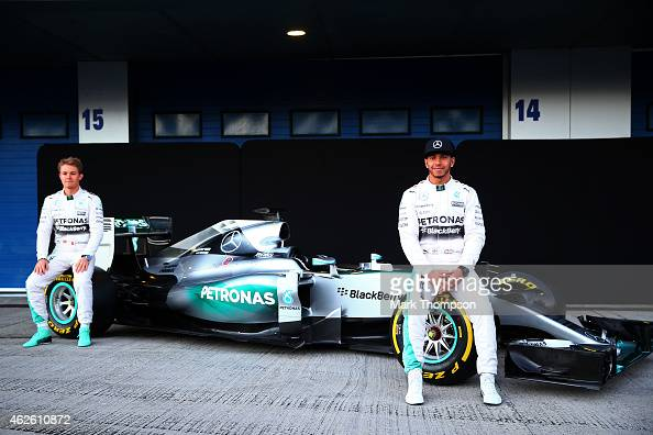 Lewis Hamilton of Great Britain and Mercedes GP and Nico Rosberg of Germany and Mercedes GP pose with the new W06 at its launch outside the team...